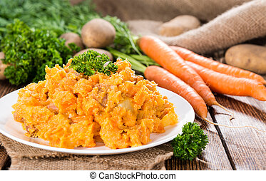 Carrot Stew - Homemade Carrot Stew (close-up shot; on rustic...