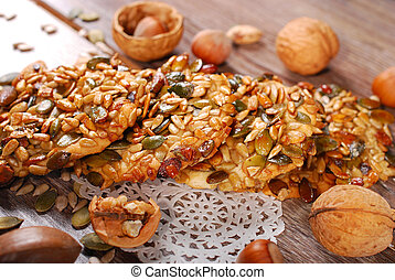 homemade healthy cereal cookies with nuts, seeds and honey on wooden table