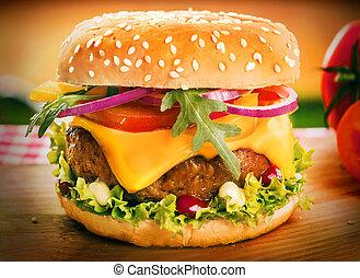 Homemade cheeseburger or burger on a sesame bun