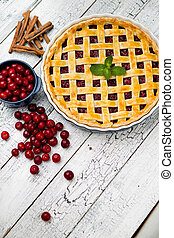 Homemade cherry pie on wooden table. Elevated view