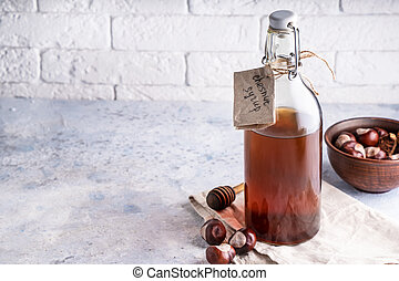 Homemade chestnut syrup in bottle Alternative food and drink Trend food 2020 Copy space.