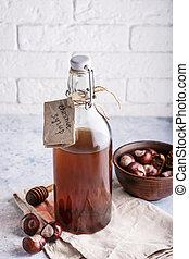Homemade chestnut syrup in bottle Alternative food and drink Trend food 2020 Vertical