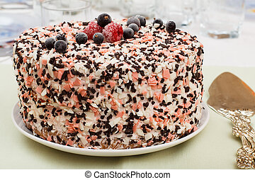 Homemade chocolate cake decorated with fresh berries.