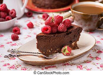 Homemade chocolate cake with raspberry