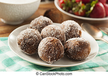 Homemade Chocolate Donut Holes with Sugar for Breakfast