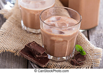 Homemade chocolate liquor with ice in glasses