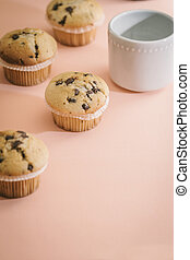 Homemade chocolate muffins with copy space area with pink background