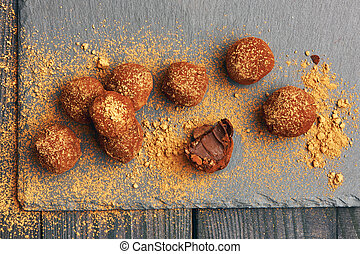 Homemade chocolate truffles on slate plate