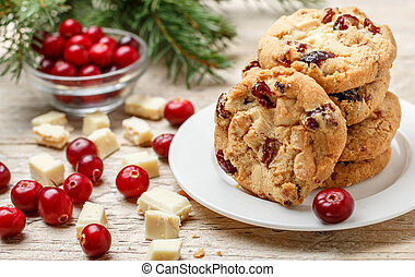 Homemade Christmas cranberry cookies with white chocolate in a bowl on the table. Rustic style. Selective focus