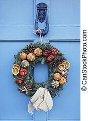 Homemade Christmas Wreath Hanging On Blue Door