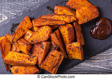 Homemade Cooked Sweet Potato with spices and herbs. -...