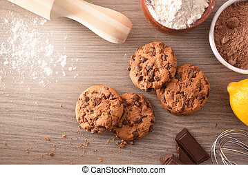Homemade cookies with chocolate chips on wooden table top view