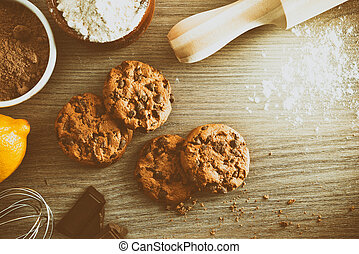 Homemade cookies with chocolate chips on wooden table top vintage