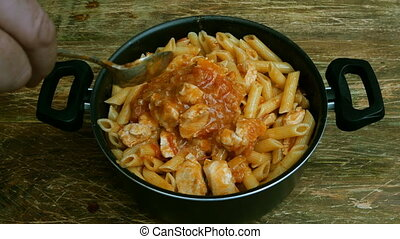 Homemade cooking. Red savory sauce with sliced chicken meat,...