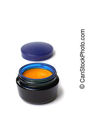 Homemade cream with sea buckthorn oil in blue glass can