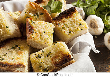 Homemade Crunchy Garlic Bread with butter and parsley