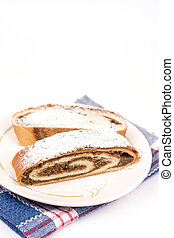 Homemade domestic strudel with walnuts on the plate
