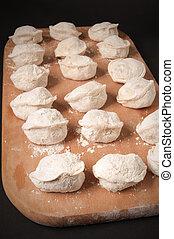 dumplings on a cutting board