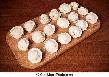 homemade dumplings on a cutting board