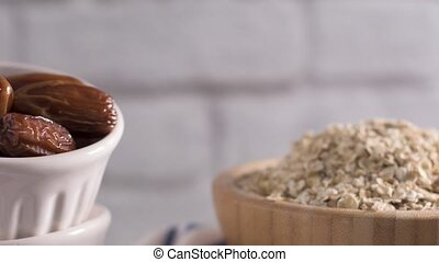 Homemade energy balls ingredients, date fruits and oat...