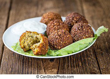 Homemade Falafel (close-up shot; selective focus) on wooden...