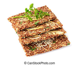 Homemade flax seed whole grain crackers isolated.
