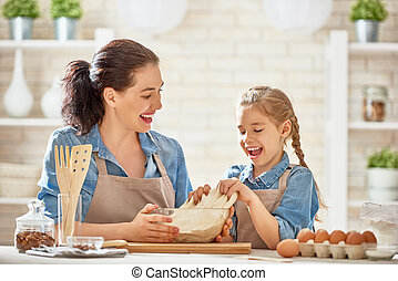 Homemade food and little helper - Happy loving family are...