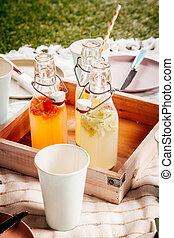 Homemade fresh fruit juice for a summer picnic