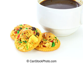 Homemade fruit cookies with cup of coffee on white background