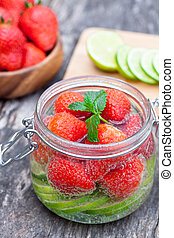 homemade fruit drink with strawberry lime and mint