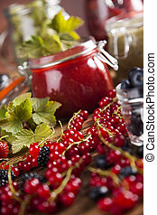 Homemade fruit jam in the jar - Jams in glass jars with wood...