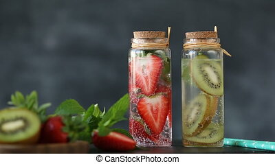 Homemade fruit water with kiwi and strawberry in jar, healthy food concept