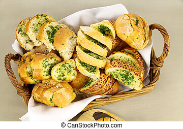 Delicious homemade herb and garlic crusty bread in a basket.