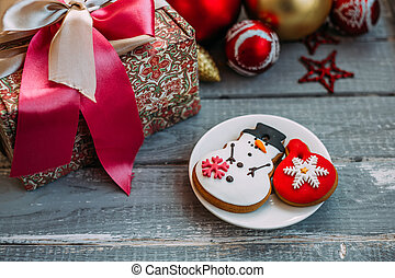 Homemade Gingerbread Cookie in the form of a snowman and Christmas toy