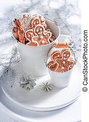 Homemade gingerbread man for Christmas in white bucket