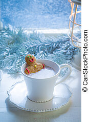 Homemade gingerbread man in hot chocolate for Christmas
