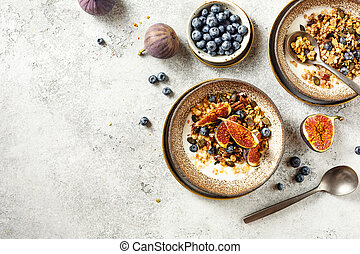 Homemade granola with yogurt and blueberry. Healthy Breakfast.