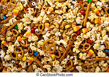 Homemade Halloween trail mix with popcorn, pretzels and nuts