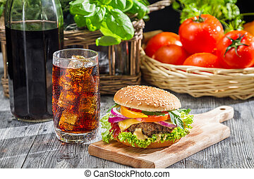 Homemade hamburger and a Coke with ice