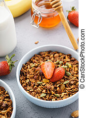 Homemade healthy oat granola with fresh berries.