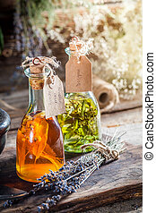 Homemade herbs in bottles as homemade cure
