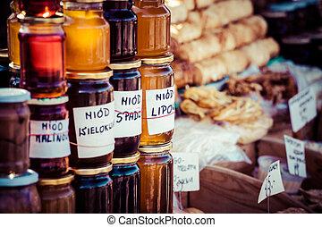 Homemade honey on the street market in Zakopane mountains, Poland.