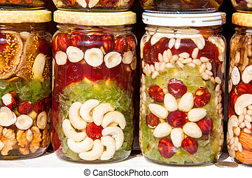 Homemade honey with dried fruits and nuts on the market