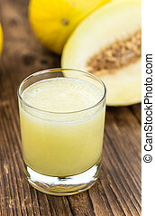 Homemade Honeydew Melon Smoothie on wooden background...