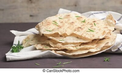 Homemade hot chapati on kitchen countertop background....