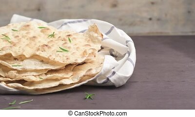 Homemade hot chapati on kitchen countertop background. Slide...
