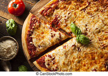 Homemade Hot Cheese Pizza with Basil and Mozzarella