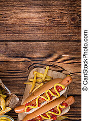 Homemade Hot Dog with ketchup and mustard on rustic wooden ...