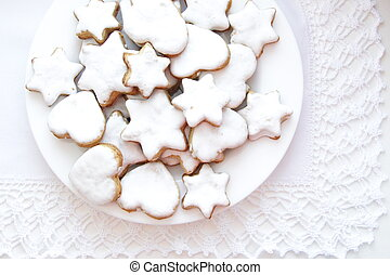 Homemade icing cookies.  Cookies in the shape of stars for Christmas and New Year.