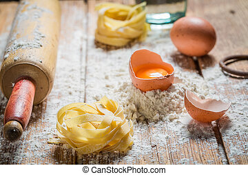 Homemade ingredients for pasta with flour and eggs